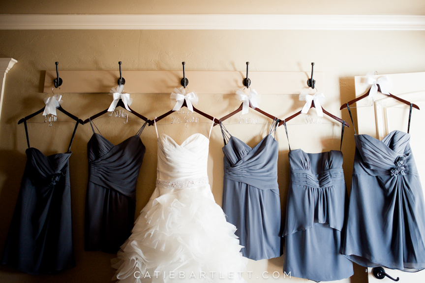 20. wedding dress and bridesmaids dresses all hanging up together ...